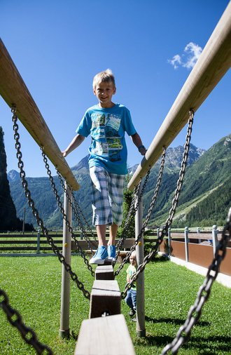 Children's playground at Alpenappart Rimlhof in Ötztal